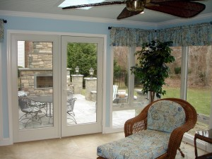 Four season sunroom with a blue painted bead board ceiling