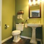 Green walls in a powder room remodel
