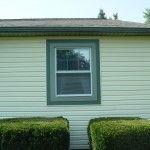Green trim capping with vinyl siding for an exterior remodel