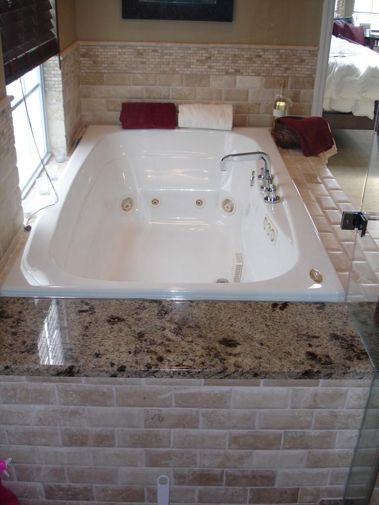 Master bathroom remodel in a condo for Bath remodel pro
