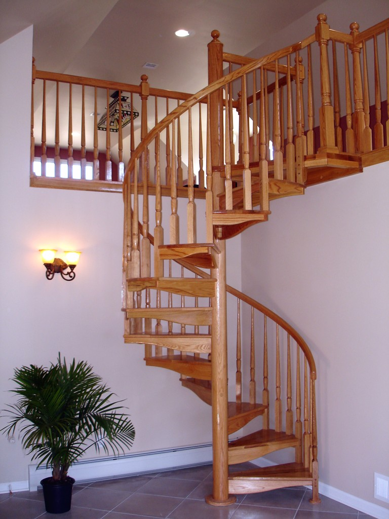Stair railing material options design build planners for Spiral staircase options