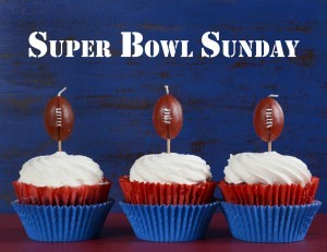 Red, white and blue theme cupcakes with football toppers for Sup