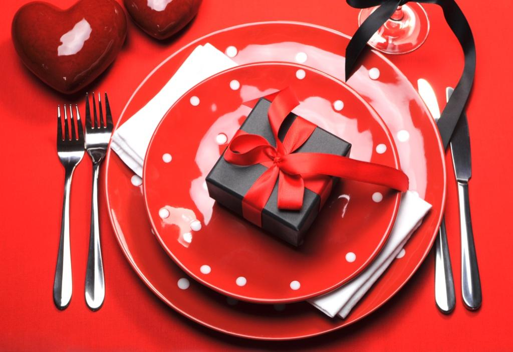 Modern red Valentine romantic table setting with red polka dot plates on bright red tablecloth with & The History of Valentine\u0027s Day - Design Build Pros