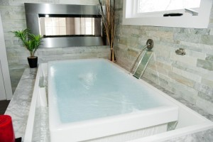 infinity soaking tub for bathroom remodeling ~ Design Build Pros (2)
