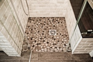 river rock pebble shower floor ~ Design Build Planners (1)