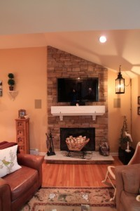 TV mounted over fireplace - Design Build Planners
