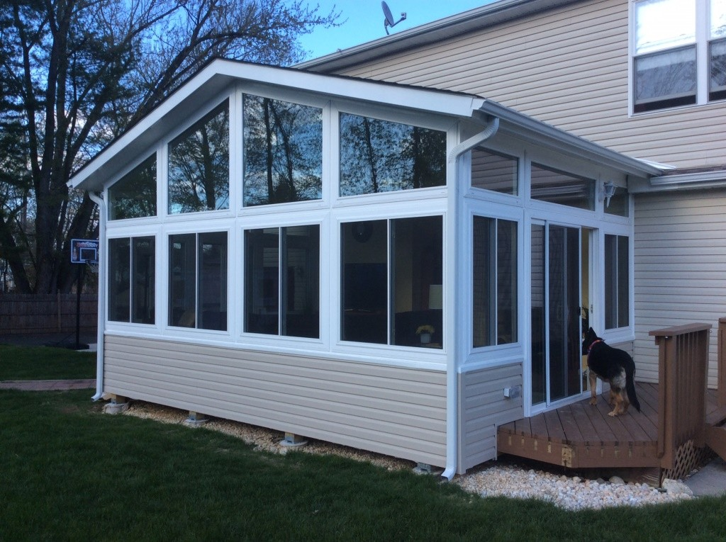 Sunroom addition for your home design build planners for Pictures of room additions
